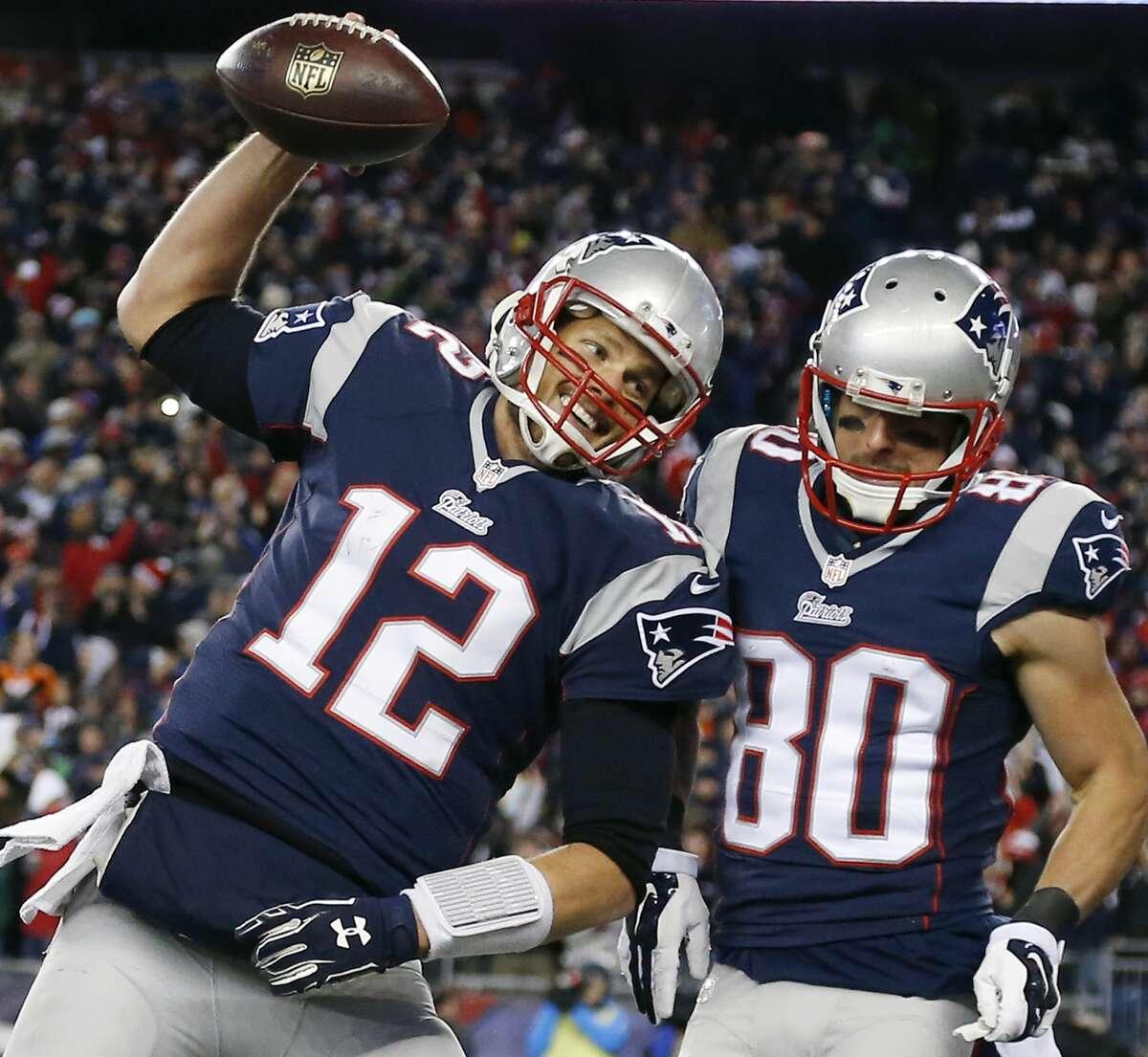 New England Patriots quarterback Tom Brady (12) celebrates with receiver Danny Amendola (80) in the first half of their Nov. 2 win over the Denver Broncos in Foxborough, Mass.
