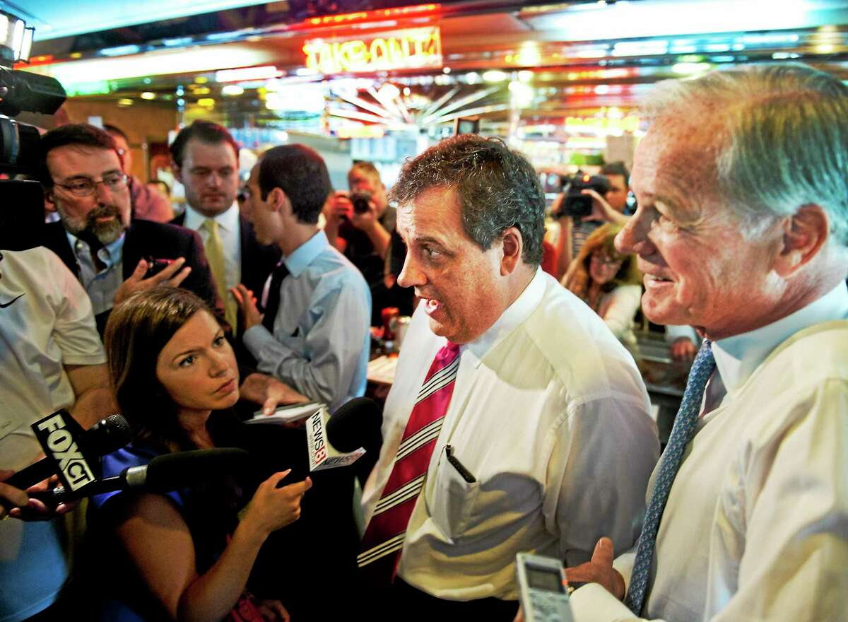 New Jersey Gov. Chris Christie (L) and republican gubernatorial candidate Tom Foley stop at the Glory Days Diner in Greenwich. 7/21