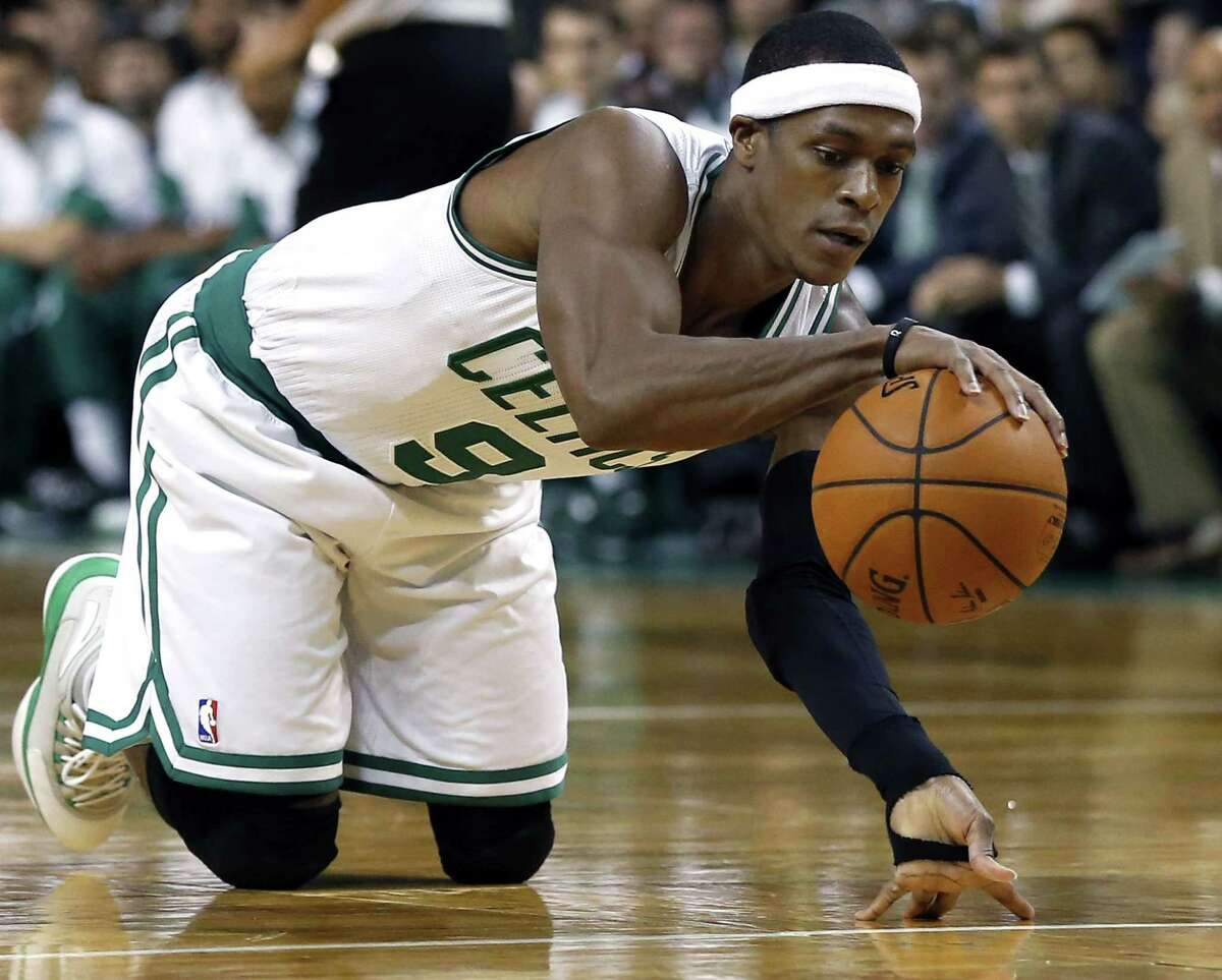 Celtics guard Rajon Rondo dribbles on his knees after recovering the ball in the first half of Wednesday's game against the Oklahoma City Thunder in Boston.