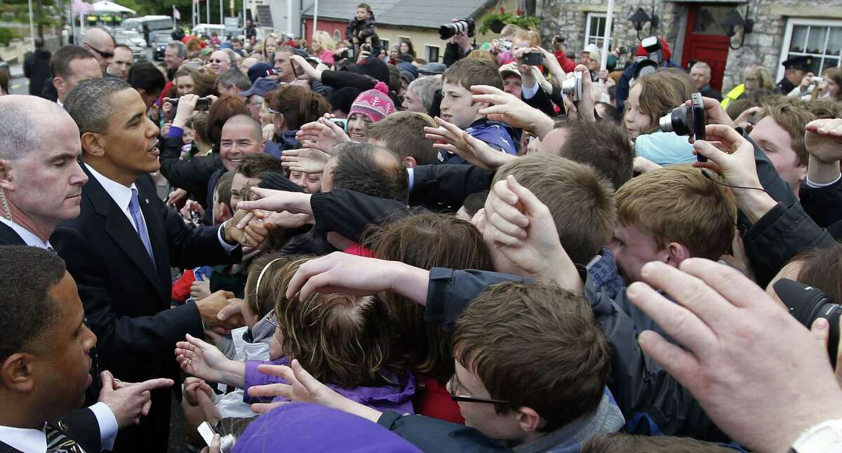 In this May 23, 2011 photo, President Barack Obama greets local residents in Moneygall, Ireland, the ancestral homeland of his great-great-great grandfather. Mark Connolly, the second-in-command on President Barack Obama's security detail, is at far left. Homeland Security is investigating two senior Secret Service agents accused of crashing a car into a White House security barrier, an agency spokesman says.