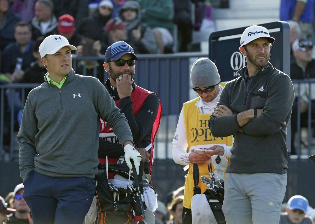 Jordan Spieth, left, and Dustin Johnson, right, wait to tee off from the 17th hole during the second round of the British Open Saturday.