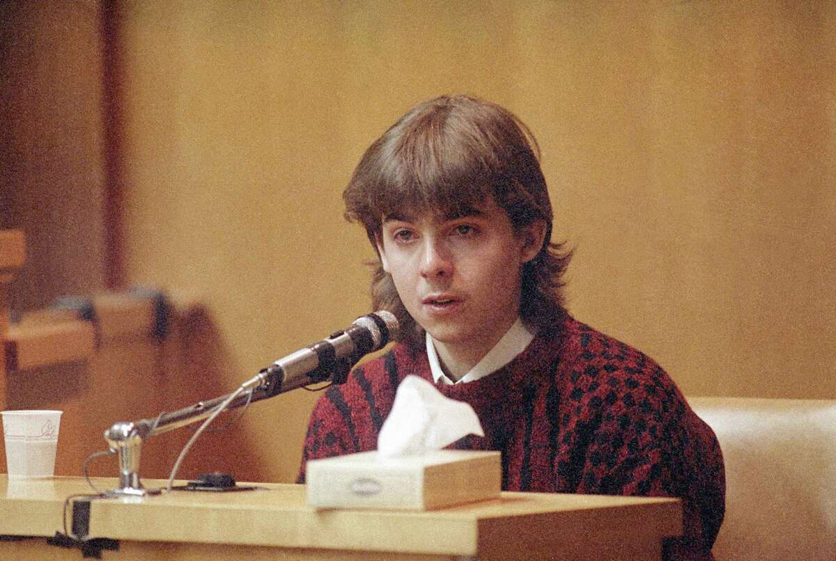 FILE - In this March 13, 1991 file photo, William Flynn, testifies on his 17th birthday how he shot Gregory Smart in the head and killed him, in court in Exeter, N.H. Smarts' widow Pamela Smart was convicted and sentenced to life without parole for conspiring with Flynn to kill her husband. Flynn pleaded guilty to killing her husband and has a parole hearing scheduled for Thursday, March 12, 2015. (AP Photo/Jim Cole, File)