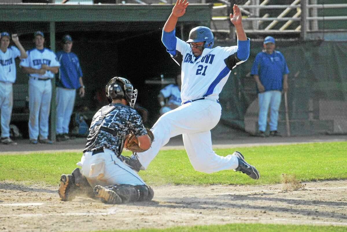Middletown's Will Woods is tagged out at home plate by Westport' catcher Adam Dulsky in the third inning.