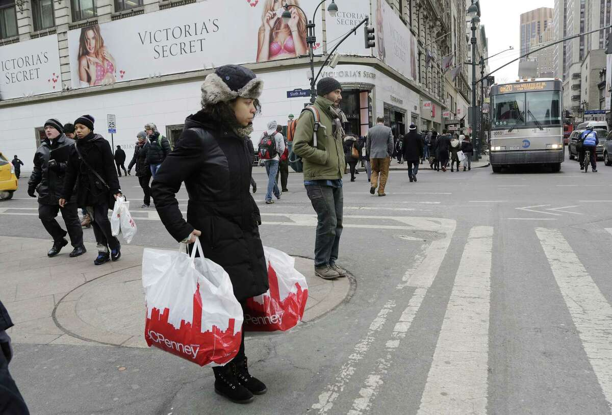 A shopper carries JCPenney shopping bags in New York.