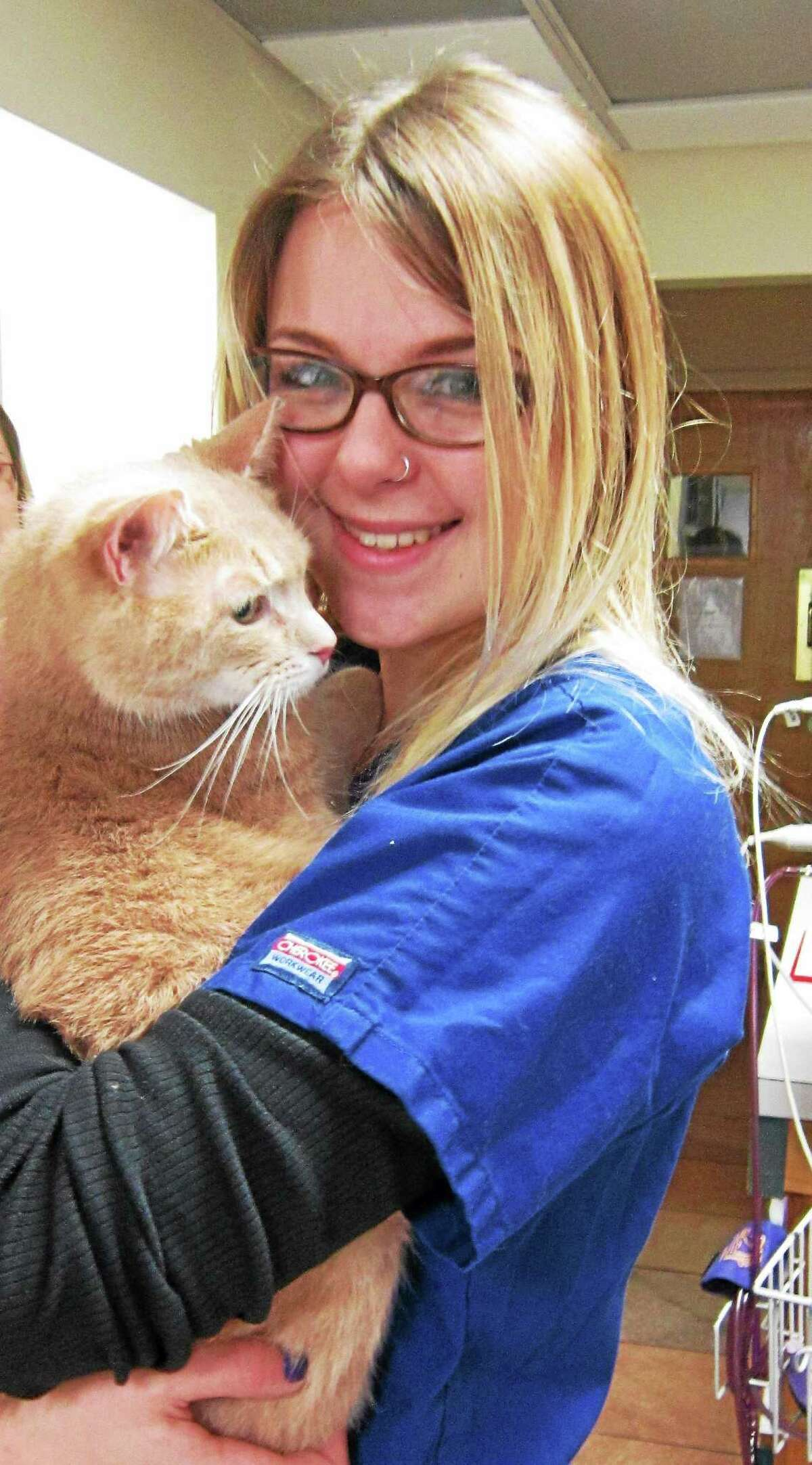 Lexi Webster holds her cat Dimitri after he is returned to her this week. Dimitri went missing in February 2014.