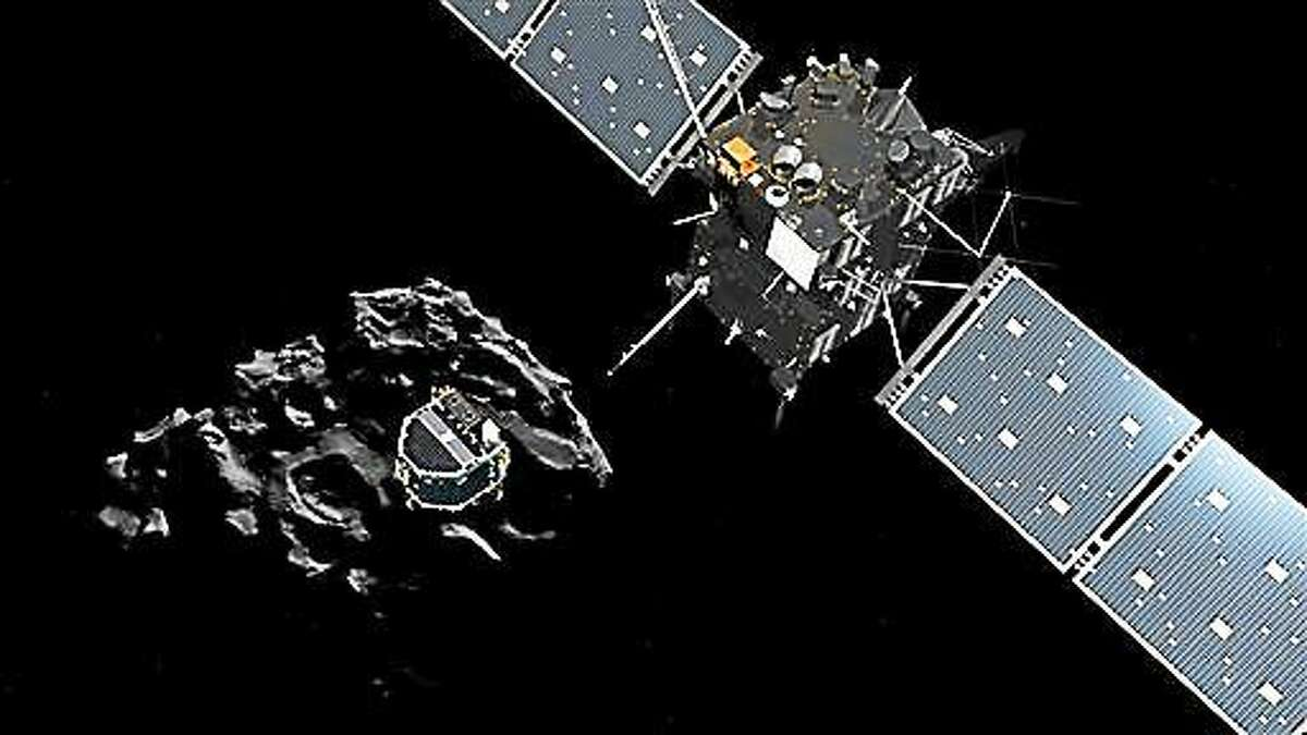 The image released by the European Space Agency ESA on Wednesday, Nov. 12, 2014 shows an artist rendering by the ATG medialab depicting lander Philae separating from Rosetta mother spaceship and descending to the surface of comet 67P/Churyumov-Gerasimenko. European Space Agency said Wednesday that the landing craft separated from Rosetta probe for descent to comet 67P.
