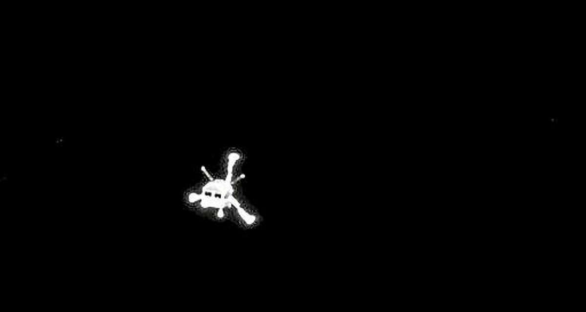 The picture of the Philae lander released by the European Space Agency ESA on Wednesday, Nov. 12, 2014 was taken by Rosetta's OSIRIS system shortly after its separation from the mother spaceship. On Wednesday, Nov. 12, 2014 the Philae lander detached from Rosetta and started it's descent to the 4-kilometer-wide (2.5-mile-wide) 67P/Churyumov-Gerasimenko comet.