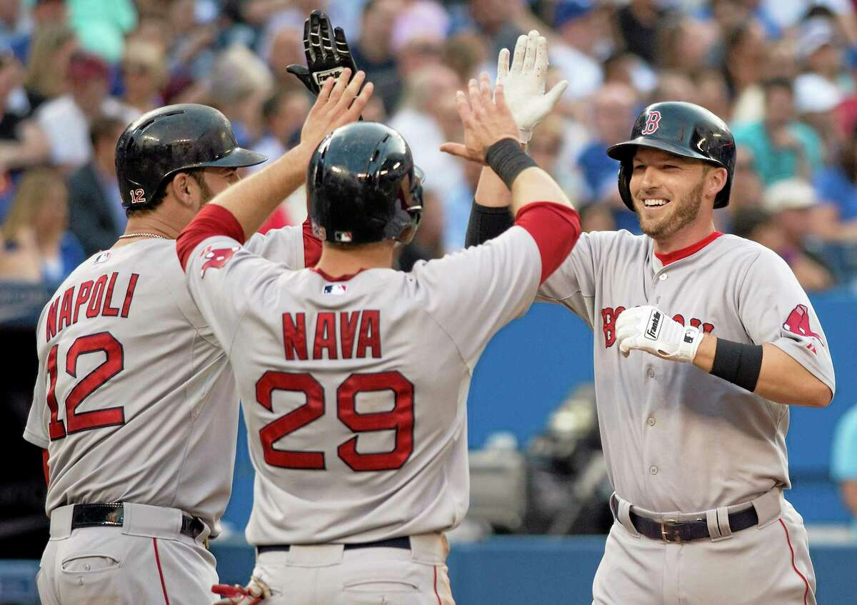 Stephen Drew, right, celebrates his three-run home run with teammates Mike Napoli, left, and Daniel Nava during the third inning Monday.