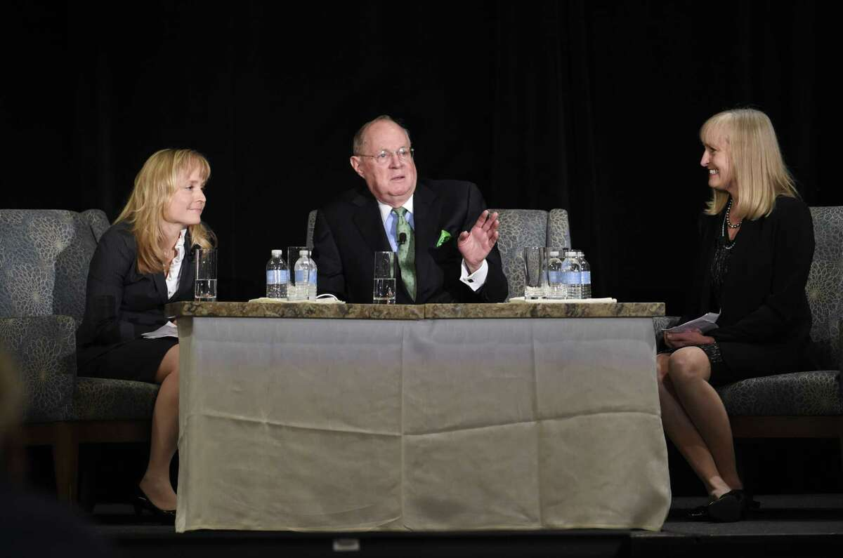 U.S. Supreme Court Justice Anthony Kennedy, center, speaks, as Margaret Mann, left, and Rebecca Pennell, left, look on at the Ninth Circuit Judicial Conference held Wednesday, July 15, 2015 in San Diego. Kennedy's appearance at the 9th Circuit Judicial Conference comes shortly after the nation's highest court put an end to same-sex marriage bans in the 14 states that still maintained them and provided an exclamation point for breathtaking changes in the nation's social norms in recent years.