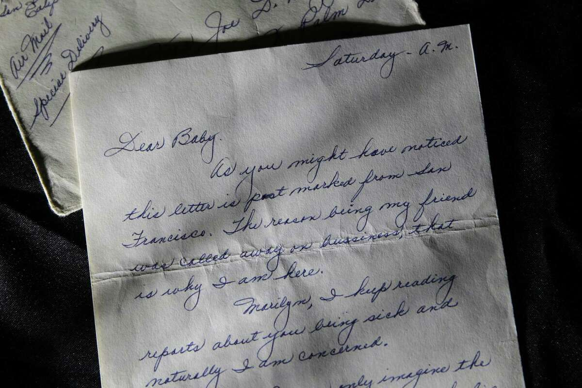 """Part of a three-page handwritten letter and original envelope postmarked Oct. 9, 1954 from baseball legend Joe DiMaggio to Marilyn Monroe on display at Julien's Auctions in Beverly Hills, Calif. The letter is among the 300 items that are part of """"Marilyn Monroe's Lost Archives"""" that go up for bid at Julien's Auctions in Beverly Hills on Dec. 5-6, 2014."""