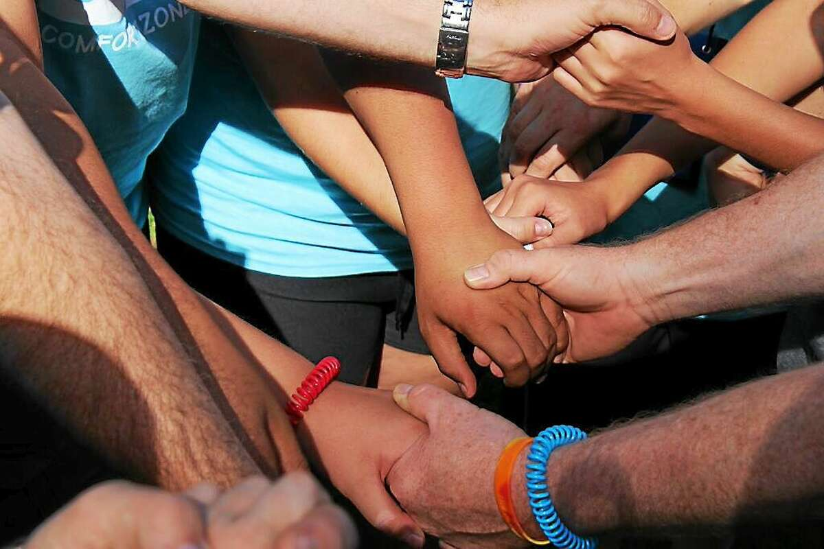 Kids learn to bond and talk about their grief experiences at the Comfort Zone Camp.