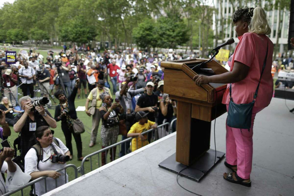 Eric Garner's mother, Gwen Carr, speaks to the crowd during a rally in New York on Saturday, July 18, 2015. Several hundred people rallied outside the federal courthouse in Brooklyn to demand action in the fatal chokehold death of Eric Garner by a white police officer.