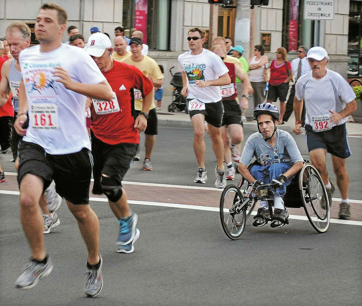 Runners compete in the 2011 Citizens Bank 5K Summer Fun Run on Main Street in Middletown.