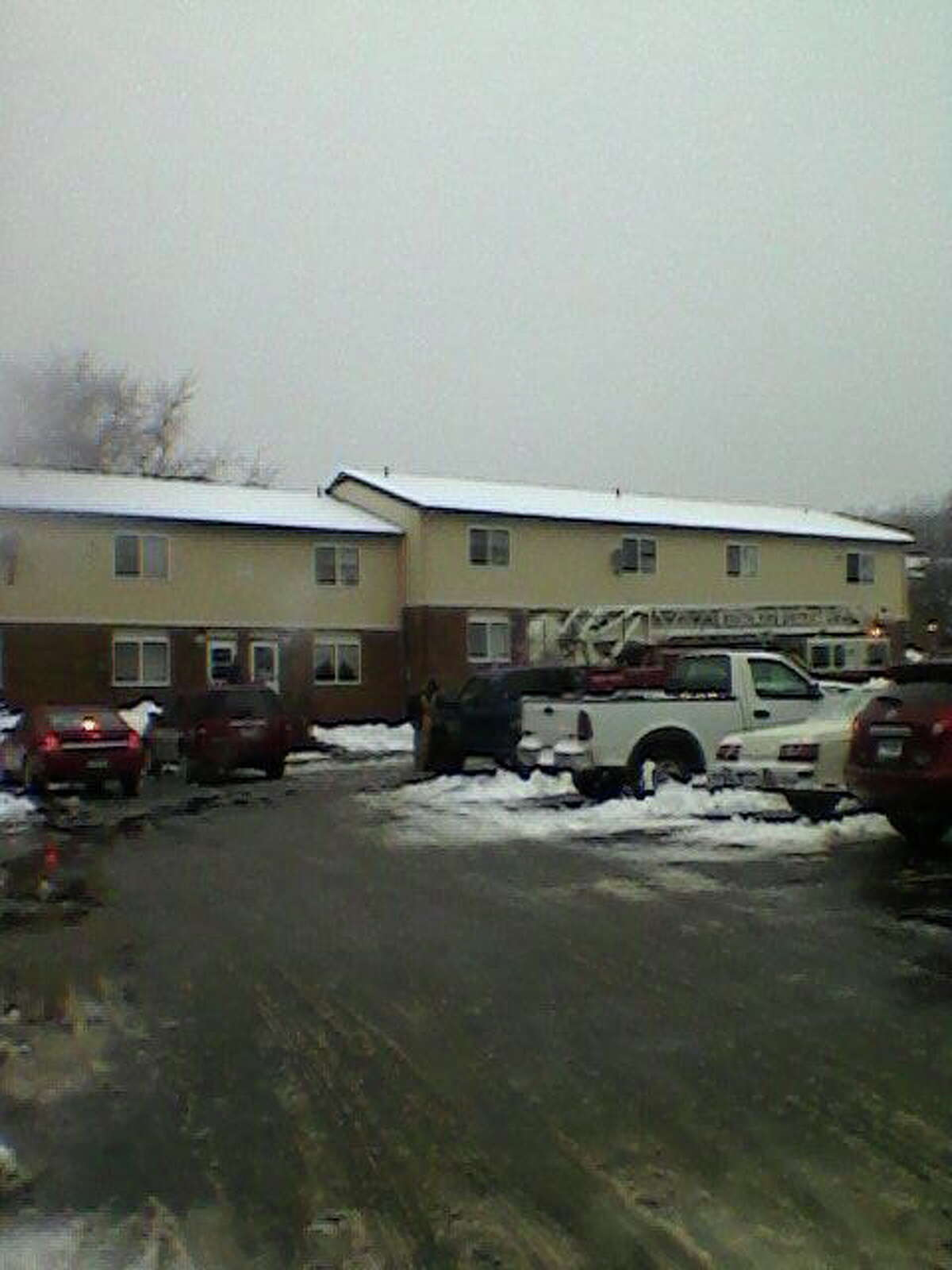 Firefighters at the scene of a fire at the Summerhill Apartments in Middletown.