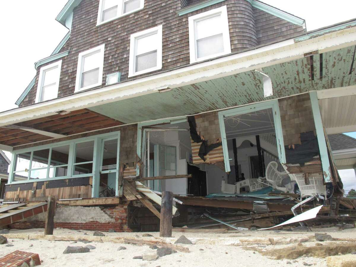 An Oct. 31, 2012 photo shows an oceanfront home in Bay Head, N.J wrecked by Superstorm Sandy two days earlier. On Tuesday Mar. 10, 2015, New Jersey state senate president Steve Sweeney introduced a bill that would require the state to give individual estimates of when Sandy victims can expect to receive rebuilding aid, and how much it will be.(AP Photo/Wayne Parry)