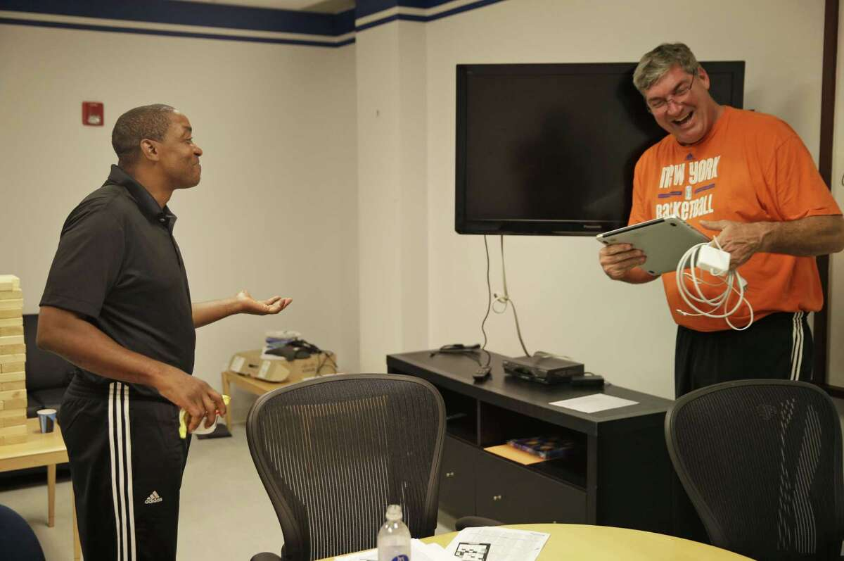 New York Liberty President Isiah Thomas, left, talks with head coach Bill Laimbeer after a coaches meeting.