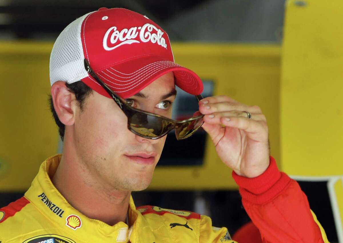 Joey Logano leaves the garage area after practice on Friday for Sunday's NASCAR Sprint Cup series race at New Hampshire Motor Speedway.