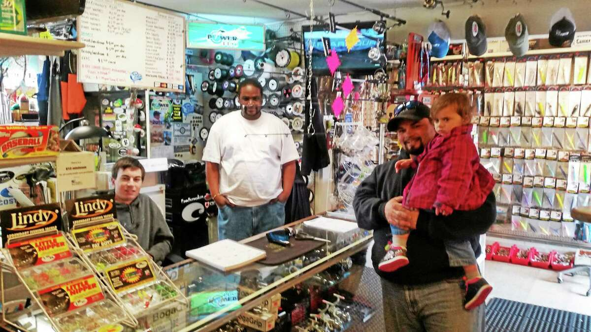 Customers and employees of the Fishin' Factory 3, 238 East Main St., Middletown, on Wednesday.