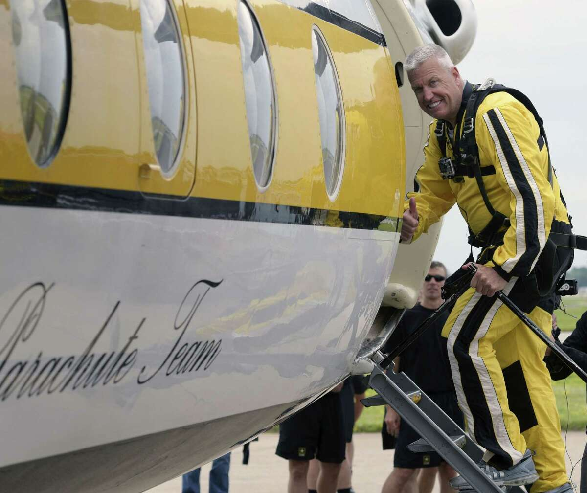 """Buffalo Bills head coach Rex Ryan gives a """"thumbs up"""" as he boards a plane for a parachute jump with the U.S. Army Golden Nights Parachute Team at Niagara Falls Air Force Base in Niagara falls, N.Y. on Friday."""