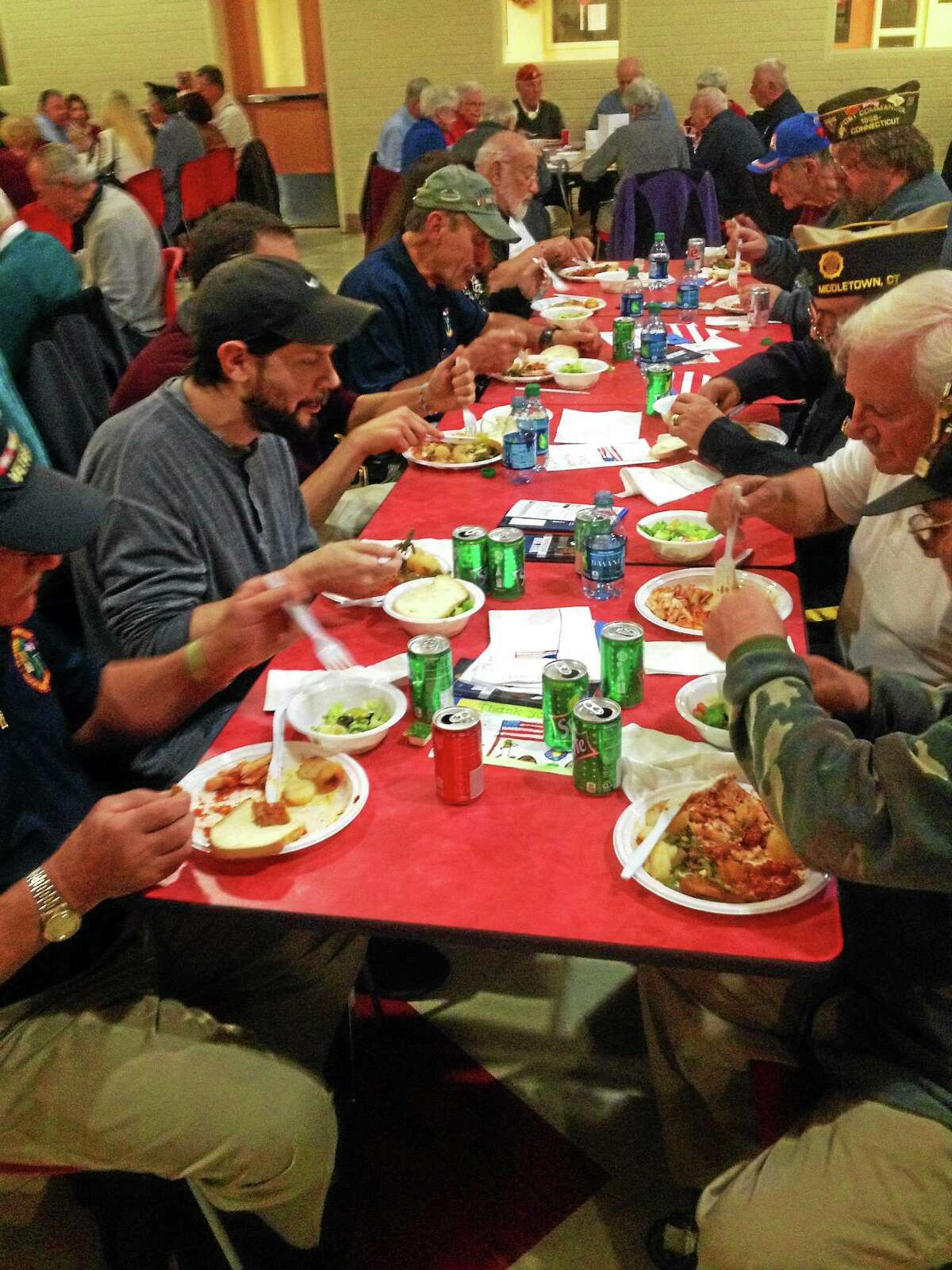 Veterans enjoyed chicken parmigiana, potatoes, green beans and shells with red sauce at the fifth annual Portland Veterans Day meal on Tuesday at the high school.
