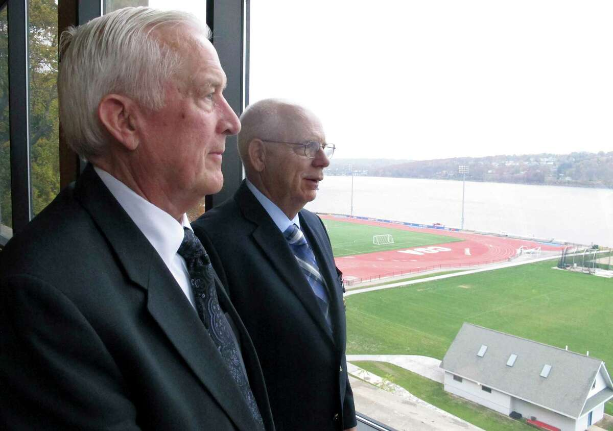 In this Nov. 6, 2015 photo, Coast Guard veterans William Carr, left, and Gordon Landon look out over the Coast Guard Academy grounds in New London, Conn.