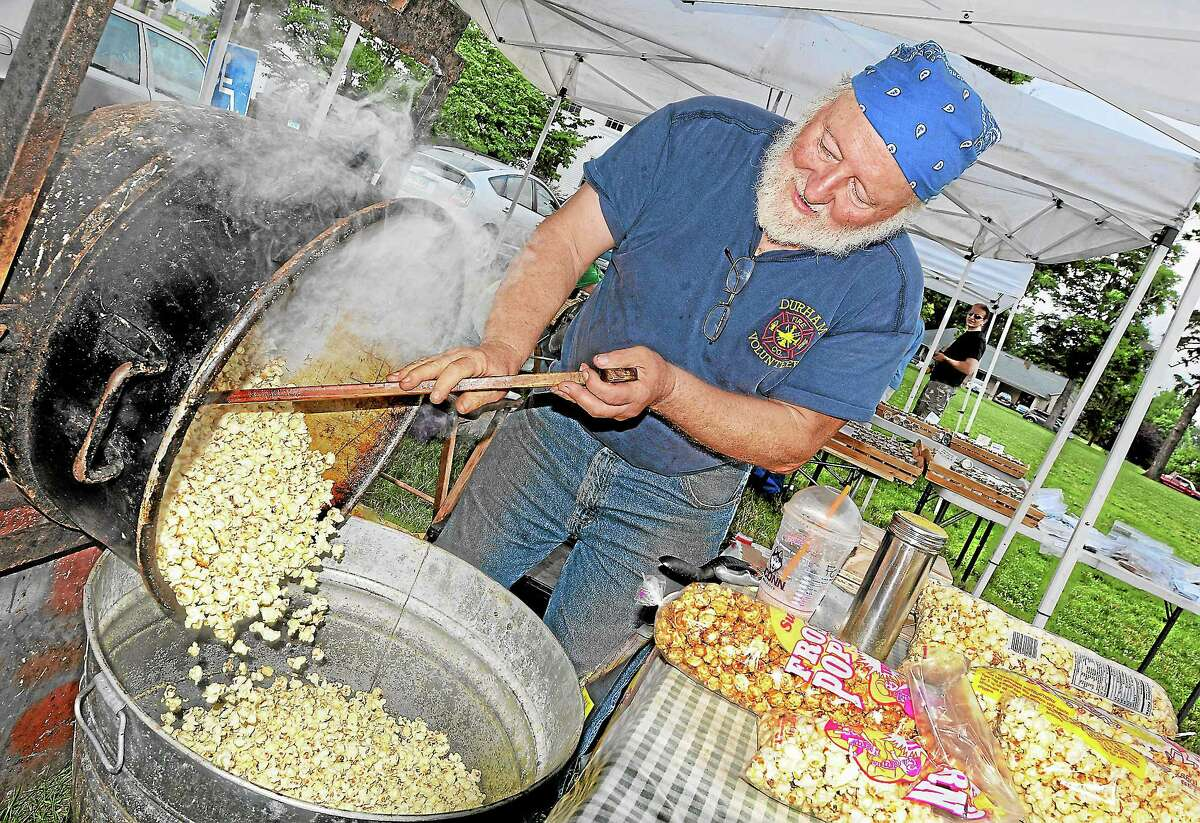 Al Kostuk, of Pisgah Mountain Primitives in Durham makes kettle corn at the Farmer's Market Thursday afternoon. The Farmer's Market is held on Thursdays from 3-6 p.m. from May through September on the Town Green on Main Street in Durham.