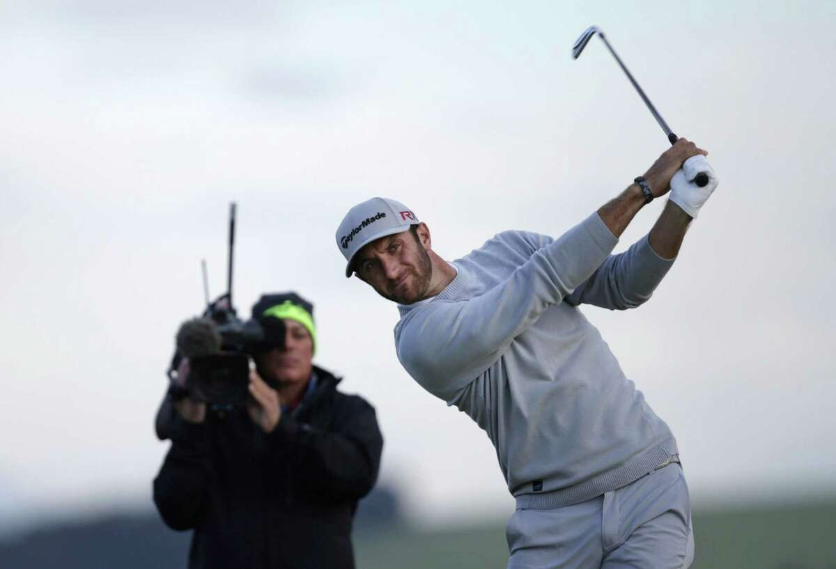 Dustin Johnson tees off from the 7th hole during the second round of the British Open on Friday.