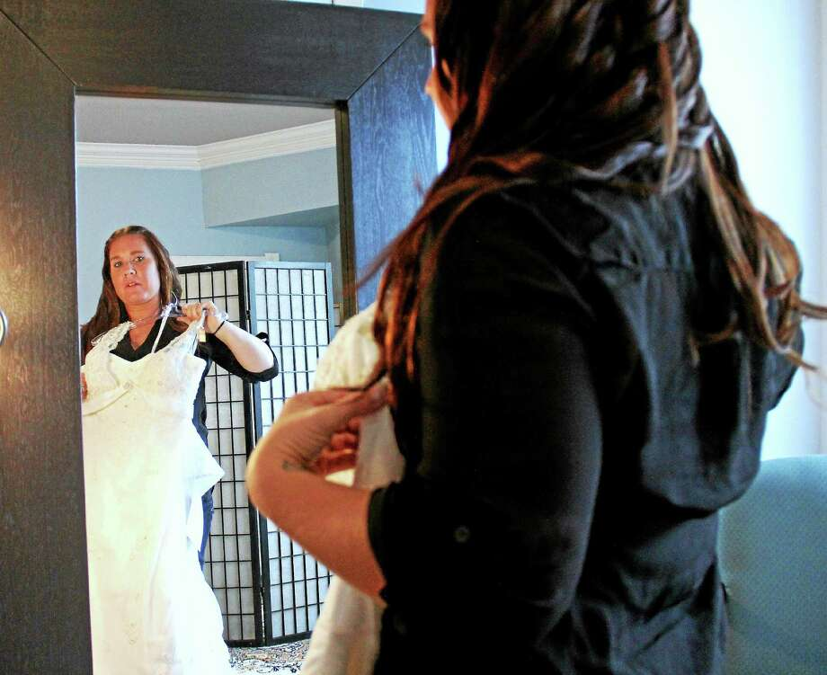 Middletown boutique offering free gowns to military brides - The ...