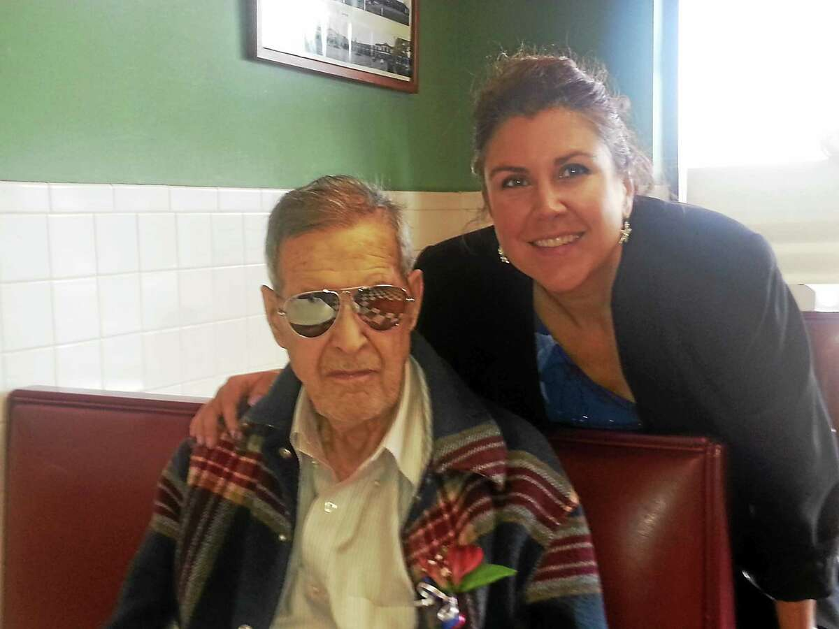 Kathleen Schassler — Middletown Press Middletown bridal shop owner Shelley Dailey enjoys a Veteran's Day visit with her father, South Windsor resident Stanley Sutherland, a U.S. Army veteran who served in World War II.