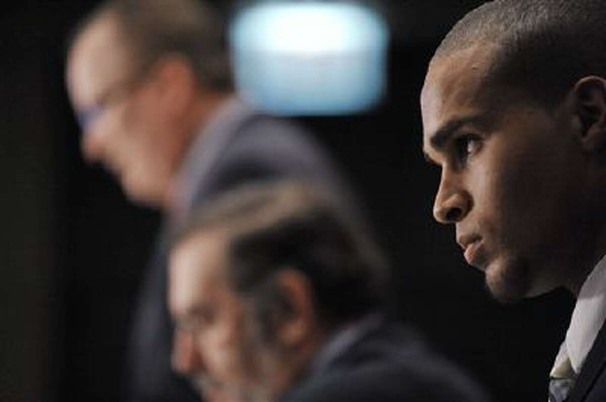 Northwestern quarterback Kain Colter looks on Jan. 28 while union officials speak during a news conference in Chicago.