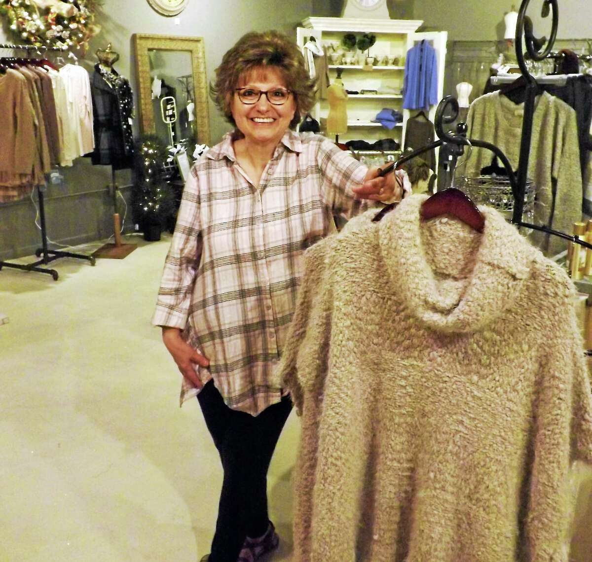 Dottie (Russo) Smith, purveyor of Pocketful of Posies in Essex, now has a second shop in Middletown's Main Street Market, right next door to her cousin Linda Przybylski's Bella Gusta Select Oils and Vinegars.