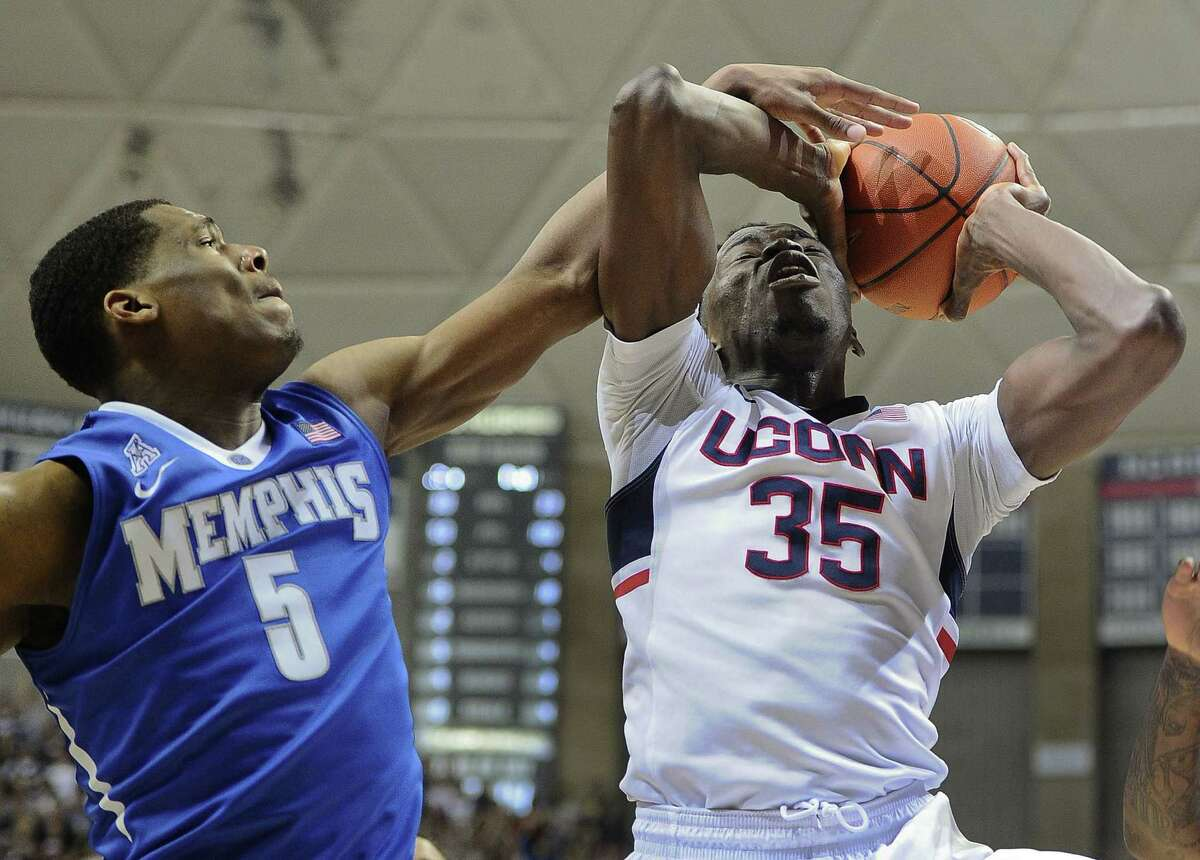 UConn's Amida Brimah, right, was named the American Athletic Conference Defensive Player of the Year on Wednesday.