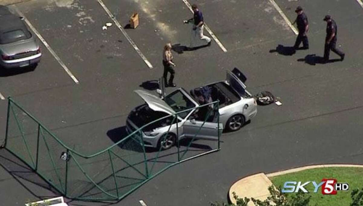 In this aerial image taken from video, law enforcement personnel work the scene of a shooting at the Navy Operational Support Center and Marine Corps Reserve Center Chattanooga Thursday in Chattanooga, Tenn.