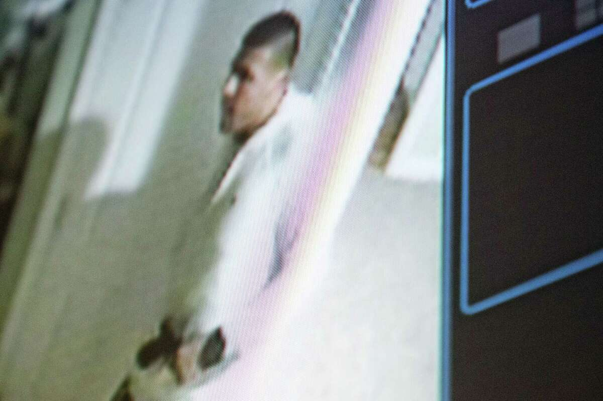 Former New England Patriot Aaron Hernandez is seen in footage from his home security system that is played during his murder trial Wednesday at Bristol County Superior Court in Fall River, Mass.