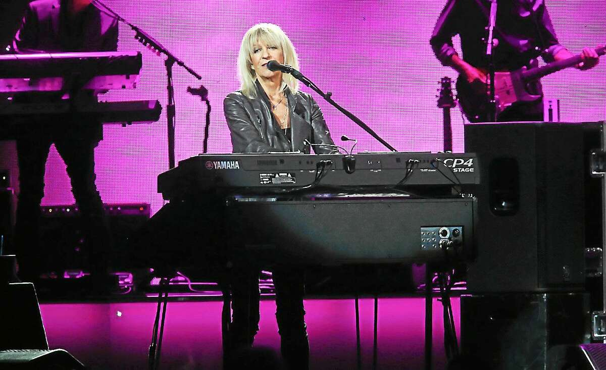 Photo by John Atashian Singer, songwriter and keyboardist Christine McVie is shown performing on stage at the XL Center in Hartford during the Fleetwood Mac concert Saturday, Nov. 1. Christine has been out of the bands for the past years and just recently reunited with the band for their current U.S. tour. She has written and sung eight songs on the bandís ìGreatest Hitsî album, including ì Donít Stop,î ìLittle Lies,î ìEverywhere,î ìYou Make Loving Funî and more. The concert performance in Hartford was completely sold out.