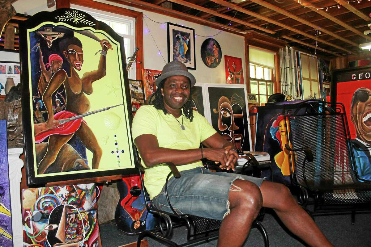 Middletown painter Pierre Sylvain is part of the Art for Haiti gallery show, a portion of which support his native country. The showcase opening at Hartford's ArtSpace, 555 Asylum Ave., on Saturday. Pierre's colorful art adorns former oil drums converted into recycling cans along Middletown's Main Street.
