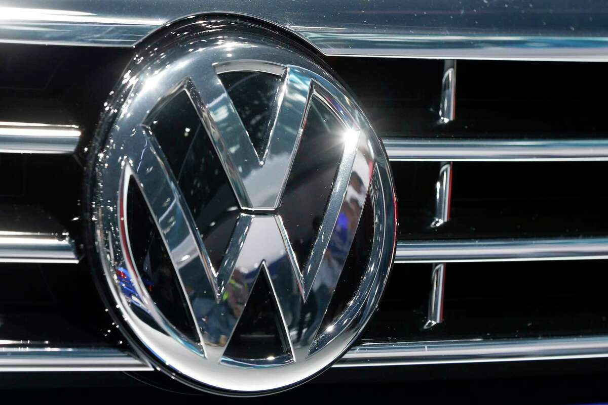 In this Sept. 22, 2015 photo, the Volkswagen logo of a car is photographed during a car show in Frankfurt, Germany.