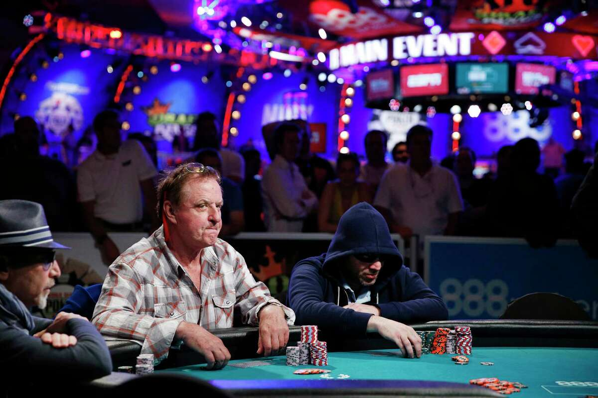 In this July 14, 2015 photo, Neil Blumenfield, Pierre Neuville and Zvi Stern, from left, compete at the World Series of Poker main event in Las Vegas. The World Series of Poker's Main Event returns Sunday, Nov. 8, offering a $7.6 million prize to the victor.