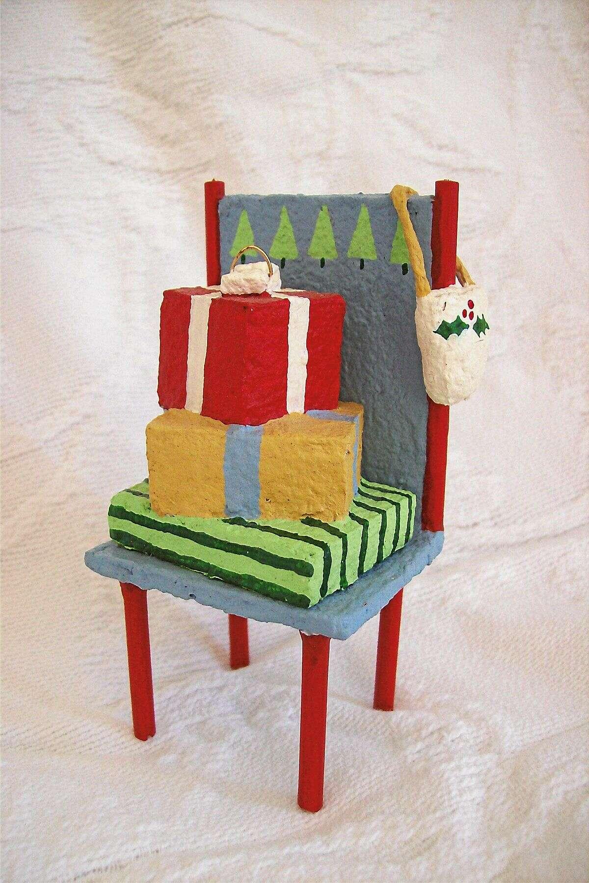 """Holiday Chair Ornament"" is a mixed media creation by Margaret von Kleist Emond."