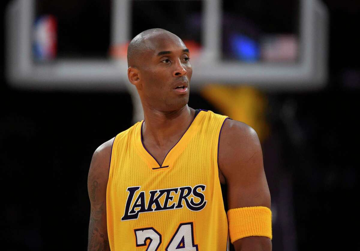 Lakers forward Kobe Bryant looks on during the first half of a recent game against the Denver Nuggets.