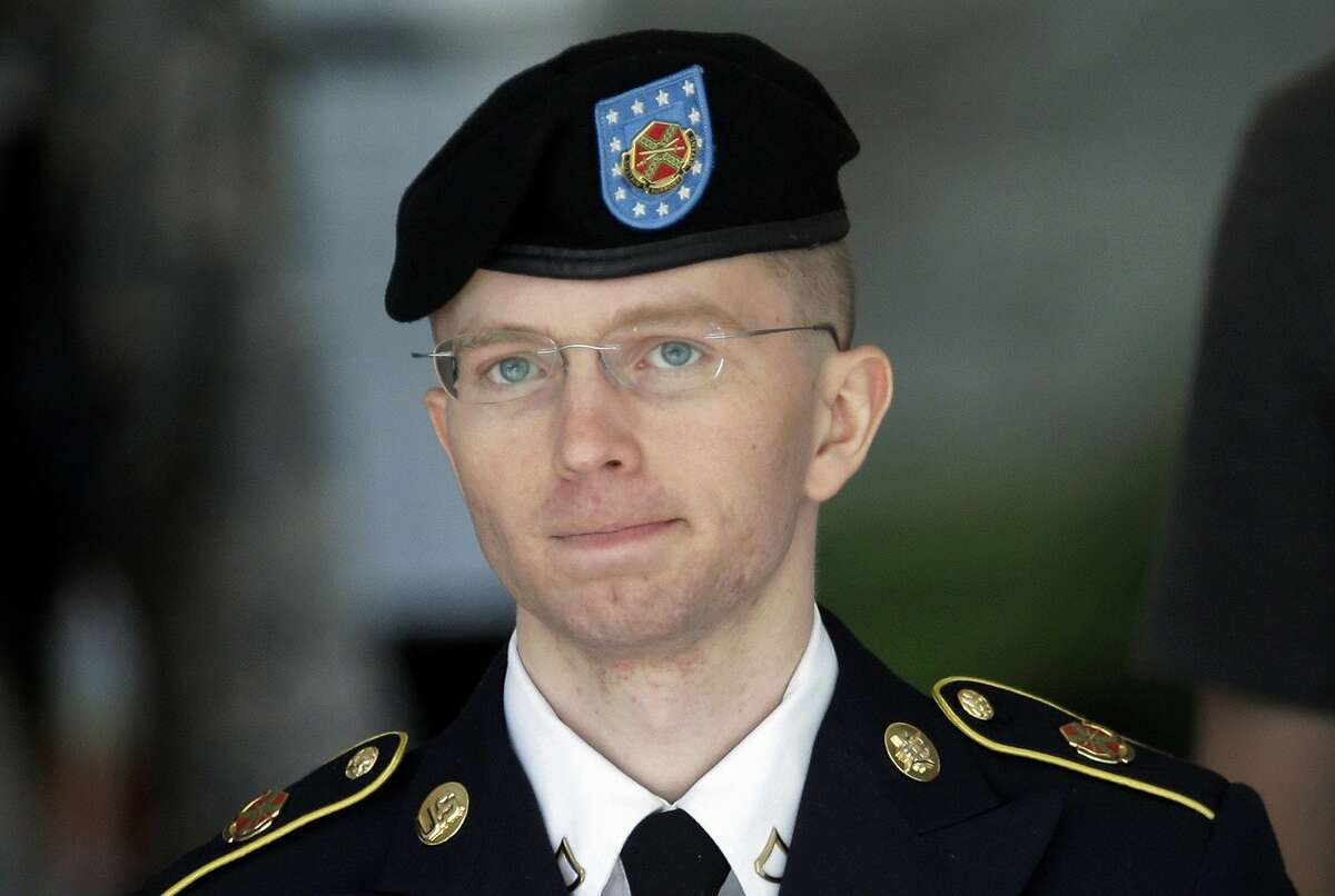 In this June 5, 2013, file photo Army Pvt. Chelsea Manning, then-Army Pfc. Bradley Manning, is escorted out of a courthouse in Fort Meade, Md., after the third day of his court martial. Pentagon leaders have announced plans aimed at lifting the ban on transgender individuals serving in the military.