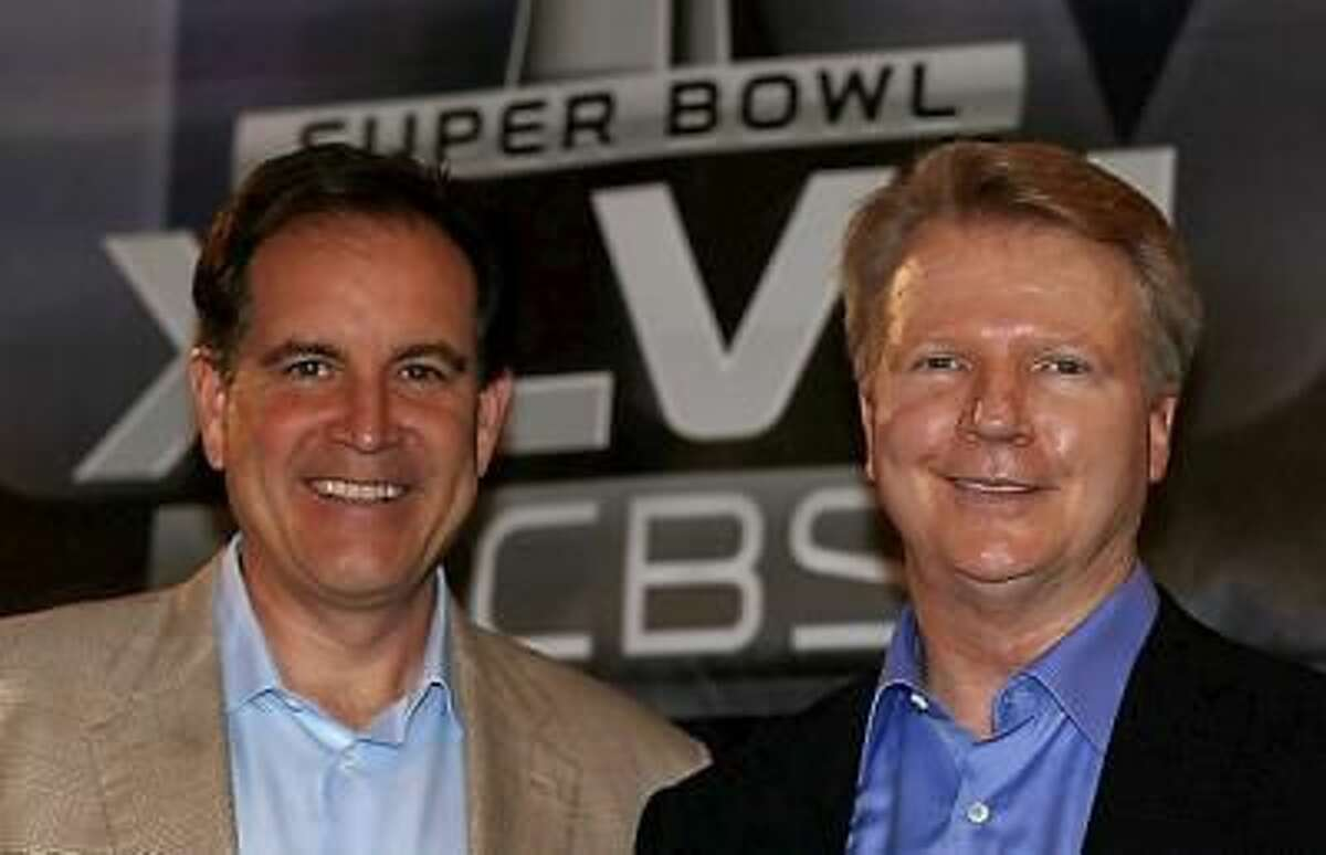 CBS Sports announcers Jim Nantz, left, and Phil Simms pose on stage at a Super Bowl XLVII Broadcasters Press Conference at the New Orleans Convention Center on January 29, 2013 in New Orleans, Louisiana.