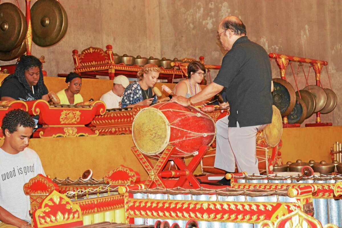 CCY students play a song on the Javanese gamelan under the instruction of I.M. Harjito.