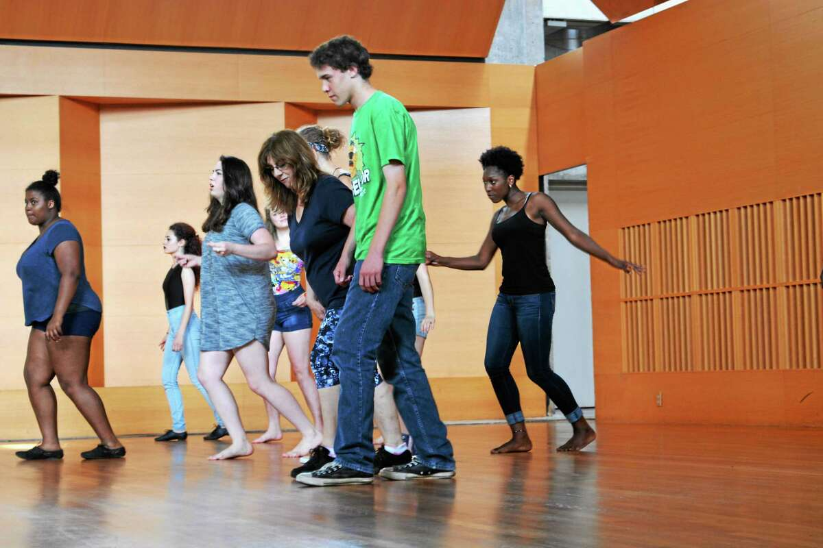CCY students rehearse dance moves with instructor RoseMarie Libera.