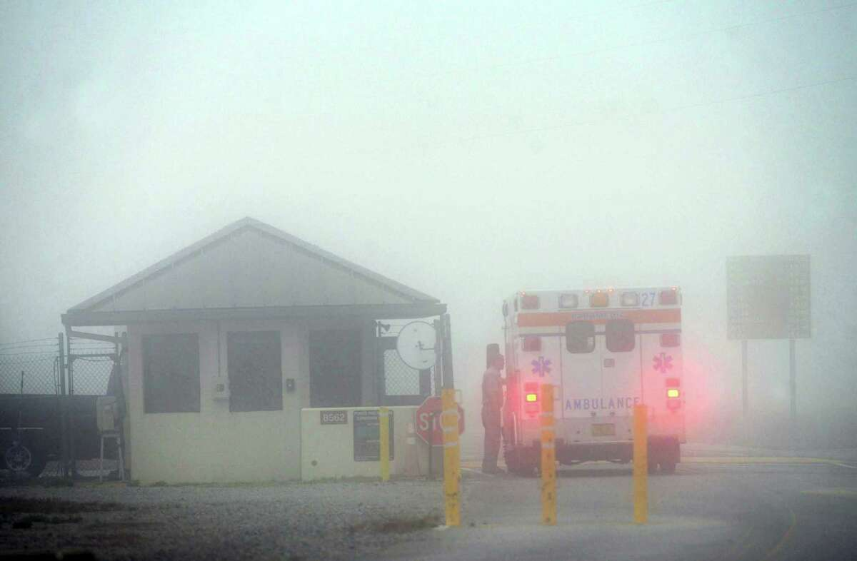 An Okaloosa County ambulance sits at the Eglin Air Force entrance in Fort Walton Beach, Fla., Wednesday, March 11, 2015. Seven Marines and four soldiers aboard an Army helicopter that crashed over waters off Florida during a routine night training mission were presumed dead Wednesday, and crews found human remains despite heavy fog hampering search efforts, military officials said.
