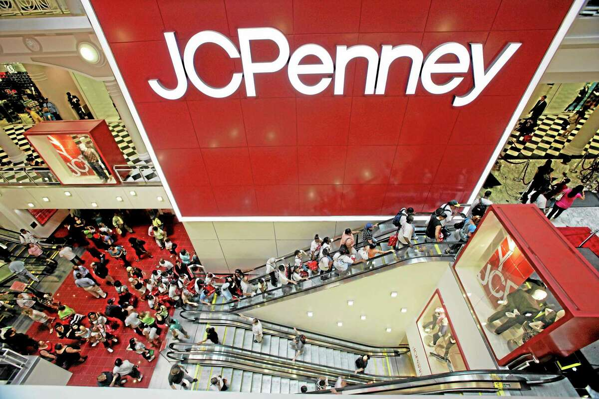 FILE - In this July 31, 2009 file photo, customers are seen in the main entrance of the new JCPenney store in the Manhattan Mall during the grand opening in New York. Tight inventory controls and exclusive store label brands pushed J.C. Penney Co. into profitability in the second quarter, Friday, Aug. 13, 2010. But the department store offered cut its profit outlook because of the uncertain economy. (AP Photo/Mary Altaffer, file)