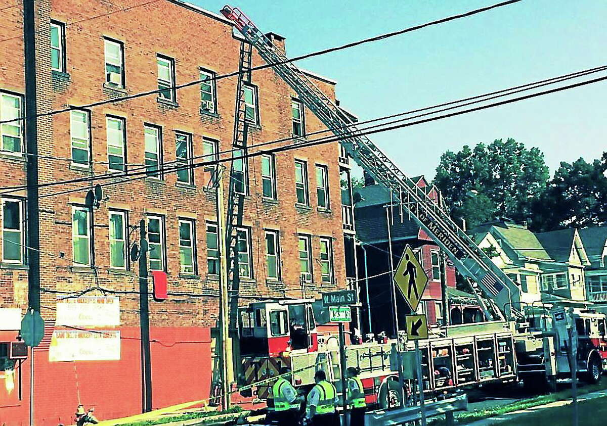A fire damaged a building at 250 W. Main St. in Meriden. Crews from multiple towns assisted with the firefighting effort.