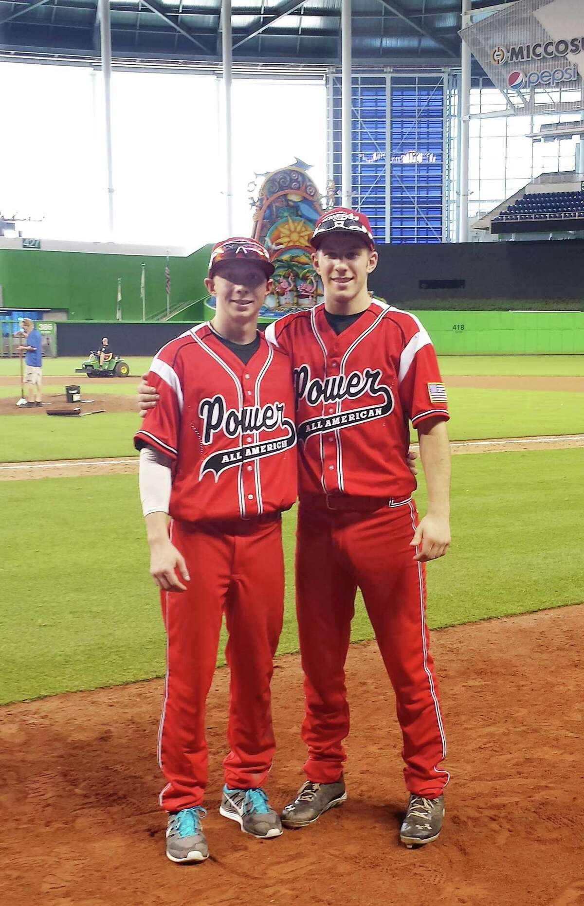 Photo courtesy of Cindy Moskey Derek Kaspercyk, left, and Brian Moskey get ready to play in the 2014 Power Showcase at Miami's Marlins Park.