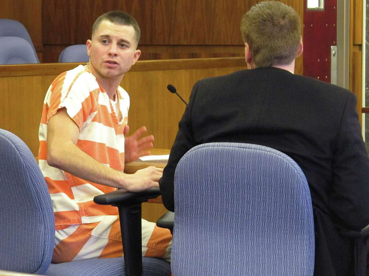 Zachary Butler, left, who pleaded guilty to reckless homicide in the jail beating of victim David Piersol, apologizes to Piersol's family at Butler's sentencing in Champaign County court while seated beside defense attorney Christopher Bucci, on Wednesday, Nov. 12, 2014, in Urbana, Ohio. A judge sentenced Butler to five years in prison for the April assault on Piersol in Tri-County Regional Jail in Mechanicsburg, Ohio.