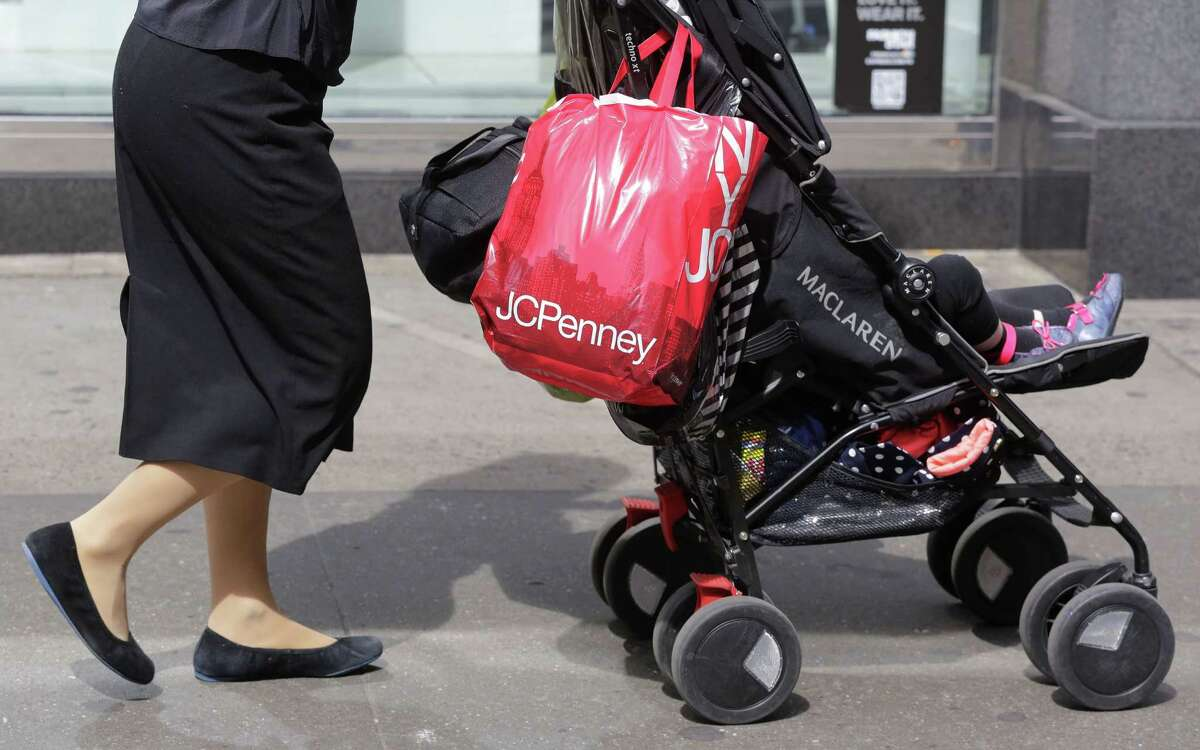 In this April 9, 2013, photo, a shopper carries a J.C. Penney bag in New York.